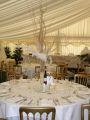 Table set up for dining in marquee in Berkshire